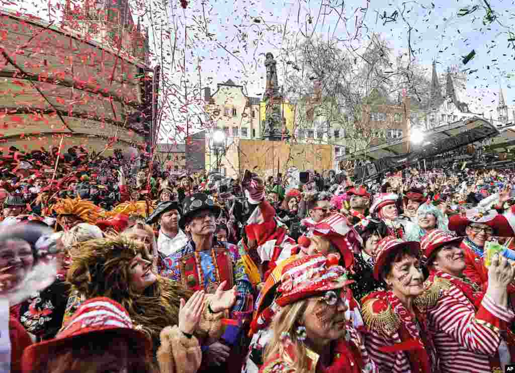 Thousands of revelers dressed in carnival costumes celebrate the start of the street carnival in Cologne, Germany.
