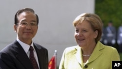 Chinese Prime Minister Wen Jiabao, stands with German Chancellor Angela Merkel. Chinese Prime Minister stays for a two day official visit in Germany, June 28, 2011