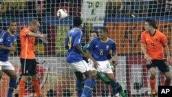 Netherlands' Wesley Sneijder, second from left, scores a goal.