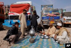 Drivers of Afghanistan-bound trucks wait for the opening of Pakistan Afghanistan border outside Peshawar, Pakistan, Tuesday, March 14, 2017. The closure of the border between Pakistan and Afghanistan, blamed on deteriorating relations, is more than inconv