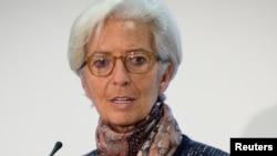 Managing Director of the International Monetary Fund Christine Lagarde speaks at a press conference at the Treasury in London, Dec. 11, 2015. A French court has ordered Lagarde to face trial over her role in a pay-out of some 400 million euros ($434 million) to businessman Bernard Tapie, her lawyer said on Dec. 17, 2015.