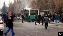 A destroyed public bus is seen at the scene of a car bomb attack in the central Anatolian city of Kayseri, Turkey, Dec. 17, 2016.