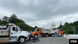 Dozens of dump trucks have been rolled out to form a security barrier ahead of a rally by supporters of former President Donald Trump at the U.S. Capitol, on Capitol Hill in Washington, Sept. 18, 2021. (Carolyn Presutti/VOA)