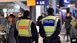 Police patrol in the main train station in Cologne, Germany, Jan. 18, 2016. Authorities have arrested a 26-year-old Algerian man on suspicion of committing a sexual assault in Cologne during New Year's celebrations.