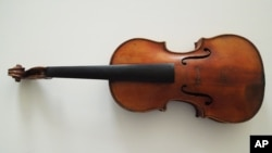 This handout photo provided by the FBI New York shows The Ames Stradivarius which was recovered by the FBI in June. Renowned violinist Roman Totenberg left his beloved Stradivarius in his office while greeting well-wishers after a concert in 1980.