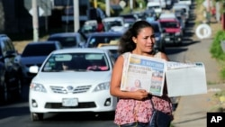 A street vendor sells La Prensa, a local newspaper showing a blank front page as a sign of protest against Daniel Ortega's government, in Managua, Nicaragua Jan. 18, 2019.