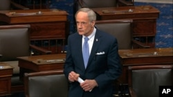 In this image from video, Sen. Tom Carper, D-Del., speaks on the Senate floor at the U.S. Capitol in Washington, D.C., March 25, 2020.