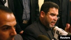 "FILE - Hamas official Salah al-Bardawil, right, talks during a news conference in Cairo, Jan. 14, 2009. Al-Bardawil on Thursday accused Israeli intelligence of being behind an IS video in order ""distort the resistance."""