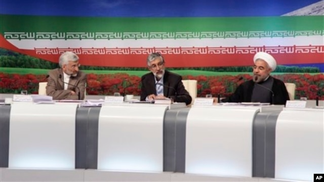 Presidential candidates from left: Saeed Jalili, Iran's top nuclear negotiator, Gholam Ali Haddad Adel, parliament lawmaker, and Hasan Rowhani, former top nuclear negotiator, attend TV debate, Tehran, June 7, 2013.