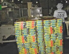 Canned fish being packed for exportation at the Indian Ocean tuna processing plant in Seychelles