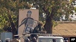 Malawi police patrol on a street of Lilongwe on July 20, 2011