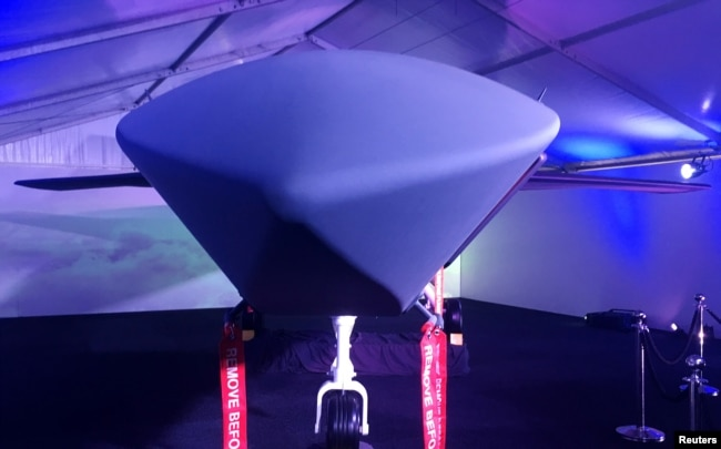 A model of Boeing CoÕs new unmanned, fighter-like jet, called the Boeing Airpower Teaming System, is displayed in Avalon, Australia, Feb. 27, 2019.