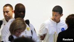 Philip Chism, 14, stands during his arraignment for the death of Danvers High School teacher Colleen Ritzer in Salem District Court in Boston, Massachusetts October 23, 2013.