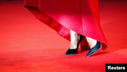 """The shoes of a model appear on the red carpet ahead of the screening of """"La Rancon de la gloire"""" (The Price of Fame), 71st Venice Film Festival, Aug. 28, 2014."""