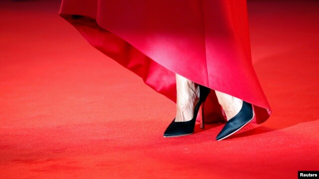 "The shoes of a model appear on the red carpet ahead of the screening of ""La Rancon de la gloire"" (The Price of Fame), 71st Venice Film Festival, Aug. 28, 2014."