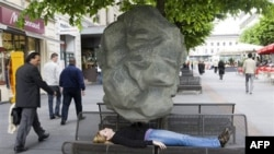 Asthmatics feel like something heavy is on their chest during an attack, as demonstrated in Geneva for World Asthma Day in 2009
