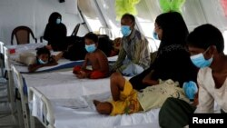 FILE - Rohingya refugees, who suffer from diphtheria, are treated at a Medecins Sans Frontieres (MSF) clinic near Cox's Bazar, Bangladesh, Dec. 18, 2017. (REUTERS/Alkis Konstantinidis)