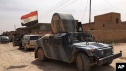 Dakarun Iraqi suna suntiri bayan da suka gama kwato birnin Fallujah