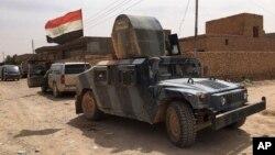 Lực lượng an ninh Iraq tuần tra sau khi đẩy lui chiến binh Hồi giáo Nhà nước ra khỏi Fallujah, ngày 26/6/2016.