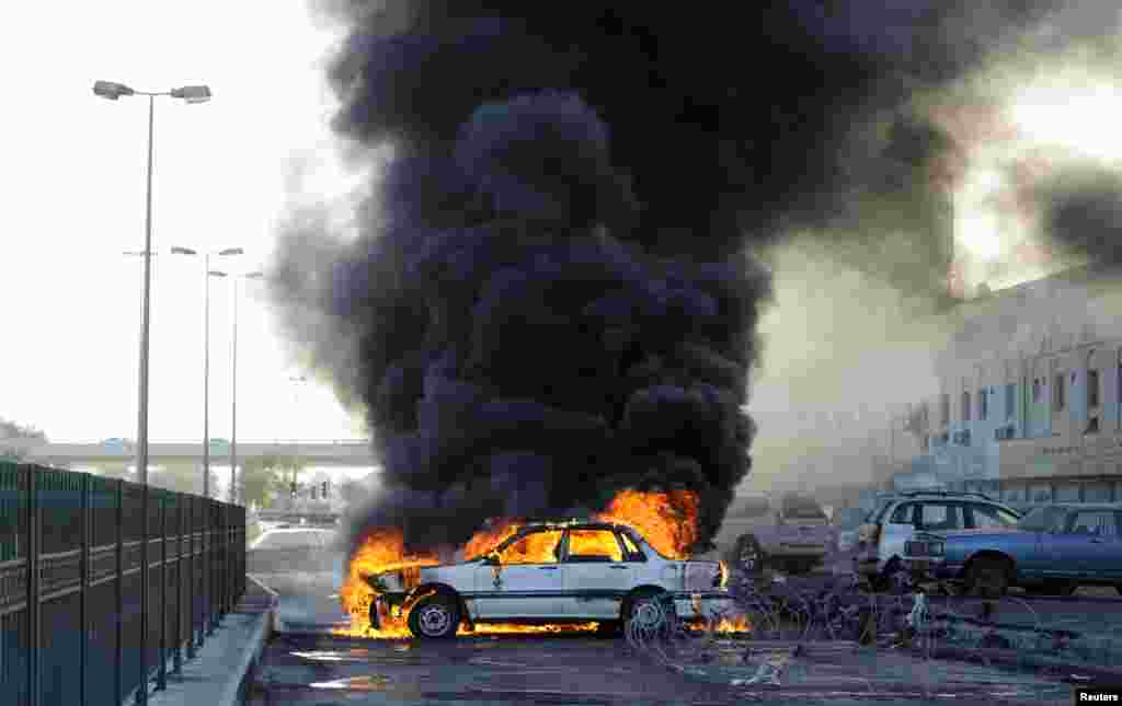 Anti-government protesters set a car on fire to create a road block to mark the second anniversary of the February 14 uprising, in Budaiya, west of Manama, Bahrain Feb. 14, 2013.