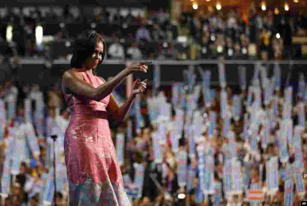 First Lady Michelle Obama waves after addressing the Democratic National Convention in Charlotte, North Carolina, September 3, 2012.