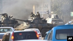 FILE: Military tanks in Harare, Wednesday, Aug, 1, 2018. r