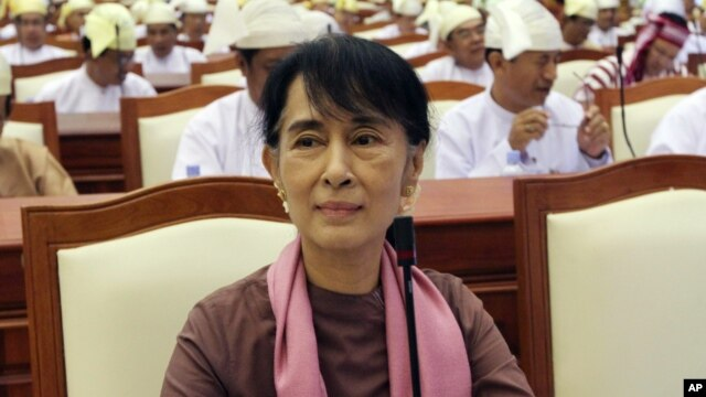 Burma's opposition leader Aung San Suu Kyi attends a regular session of the parliament in Naypyitaw, August 14, 2012.
