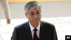 中国驻韩国大使邱国红抵达韩国外交部,韩方召见中国大使,提出抗议(2016年10月11日)