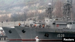 Russian military vessels are anchored at a navy base in the Ukrainian Black Sea port of Sevastopol in Crimea, Feb. 27, 2014.