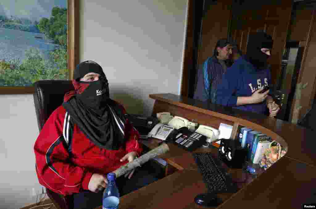 Pro-Russian activists are seen inside the regional government headquarters in Luhansk, Ukraine, April 29, 2014.
