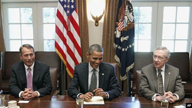 President Barack Obama sits with House Speaker John Boehner of Ohio (L), and Senate Majority Leader Harry Reid, as he met with Republican and Democratic leaders regarding the debt ceiling, at the White House in Washington, DC, July 14, 2011