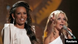 FILE - Spice Girls Mel B and Geri Halliwell (R) accept the award for Brits Performance of 30 years at 30th Brit Awards ceremony in London, Feb. 16, 2010.