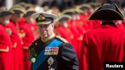 FILE - Britain's Prince Andrew reviews Chelsea Pensioners during the Founder's Day Parade at the Royal Hospital Chelsea in London, Britain, June 4, 2015.
