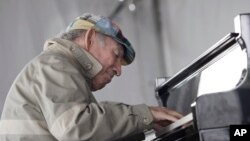 FILE - Newport Jazz Festival founder George Wein performs during the festival in Newport, Rhode Island, August 9, 2009.