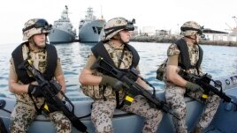FILE - German special forces are seen on a speed boat in front of the German frigates Karlsruhe, left, and Mecklenburg-Vorpommern in Djibouti, Dec. 23, 2008.