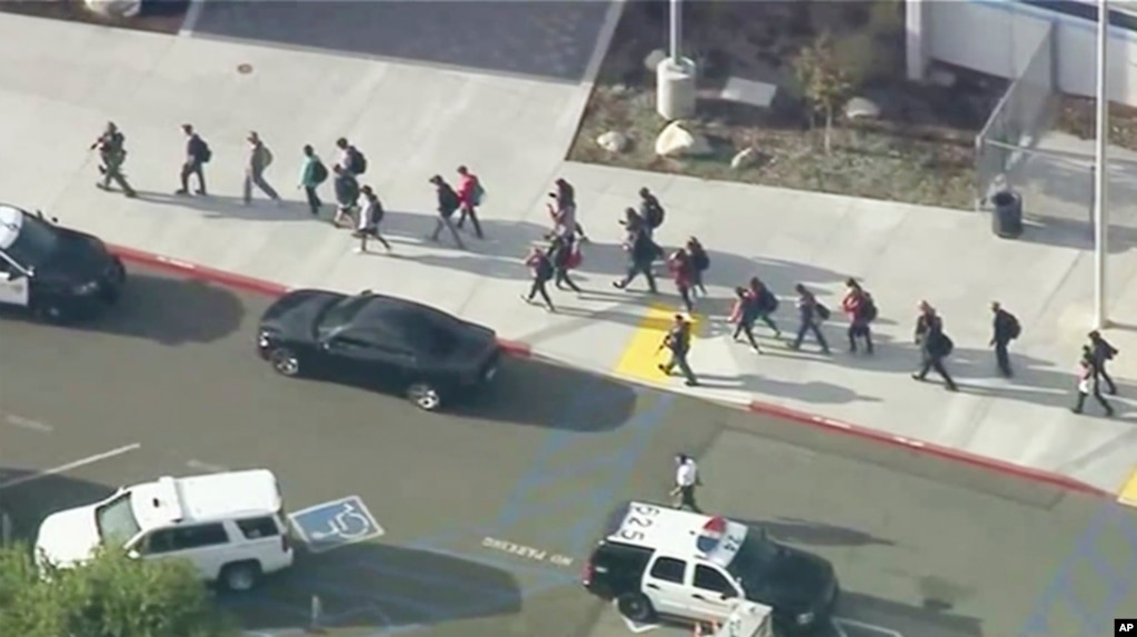 Students are lead out of Saugus High School after reports of a shooting in Santa Clarita, California. (Credit: KTTV-TV)