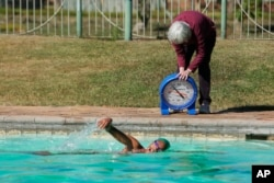 onata Katai is seen during a swimming practice session in Harare, Zimbabwe, Saturday, July 10, 2021. The southern African nation is sending the black swimmer to the Olympics, the first from her country to the Games. (AP)