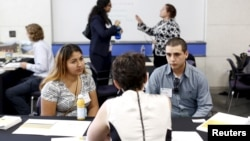 Job seekers work with recruiters at GRID Alternatives solar job fair in San Francisco, California July 15, 2015. The job fair featured 20 solar industry companies offering up to 200 open positions.