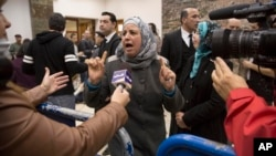 Suha Abu Khdeir, center, mother of Mohammed Abu Khdeir, a 16-year-old Palestinian murdered in 2014, speaks to reporters at a court during the sentencing of two Israelis accused of his murder, in Jerusalem, Feb. 4, 2016.