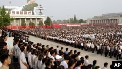 Tens of thousands of North Koreans celebrate construction of the massive Masik ski resort at a rally at Kim Il Sung Square on Pyongyang, June 14, 2013.