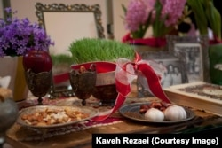 "Garlic, apples, and 'sabzeh' are part of a Persian ""haft seen"""