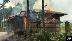 Flames engulf a house in Gawdu Zara village, northern Rakhine state, Myanmar, Sept. 7, 2017. Security forces and allied mobs have burned down thousands of homes in Northern Rakhine state, where the vast majority of the country's 1.1 million Rohingya lived, in recent weeks.