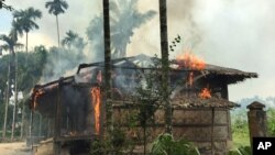 Flames engulf a house in Gawdu Zara village, northern Rakhine state, Myanmar, Sept. 7, 2017. Security forces and allied mobs have burned down thousands of homes in Northern Rakhine state, where the vast majority of the country's 1.1 million Muslim Rohingyas lived.