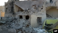 FILE - This photo provided by the Shafak Charity Organization, which has been authenticated based on its contents and other AP reporting, shows shows the badly damaged exterior of a medical facility dedicated to women after it was hit by four airstrikes.