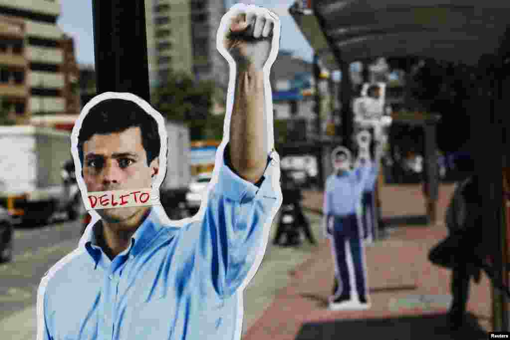 Cardboard figures of jailed opposition leader Leopoldo Lopez with his mouth covered with the word 'Crime' are seen during a gathering in support of him in Caracas, Venezuela.