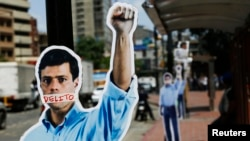 FILe - Cardboard figures of jailed opposition leader Leopoldo Lopez with his mouth covered with the word 'Crime' are seen during a gathering in support of him in Caracas June 4, 2014.