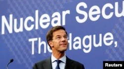 Dutch Prime Minister Mark Rutte is seen at a news conference on the eve of a Nuclear Security Summit in The Hague March 23, 2014.