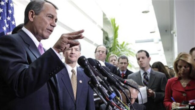 House Speaker John Boehner of Ohio, and Rep. Jeb Hensarling, R-Texas, meet with reporters on Capitol Hill in Washington after their closed GOP caucus meeting ahead of President Barack Obama's State of the Union speech, 25 Jan 2011