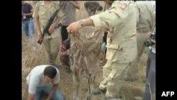 Qeveria kalimtare në Libi thotë se ka zbuluar një varrezë masive
