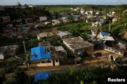 Hurricane Maria destroyed or significantly damaged more than a third of about 1.2 million occupied homes on the island, the government estimates. Damaged houses are seen at squatter community of in Canovanas, Puerto Rico, Dec. 9, 2017.